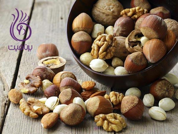 با این مواد غذایی، مو و ناخن خود را تقویت کنید- آجیل- برنافیت دکتر کرمانی