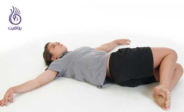 حرکات اصلاحی- Lying_Knee_rotate- برنافیت
